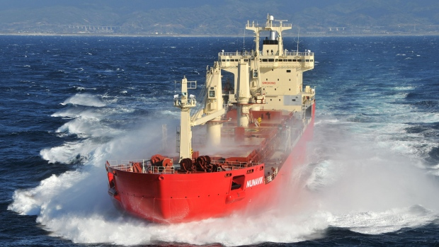The MV Nunavik sets sail, with all the forces of globalization behind it. © Fednav.