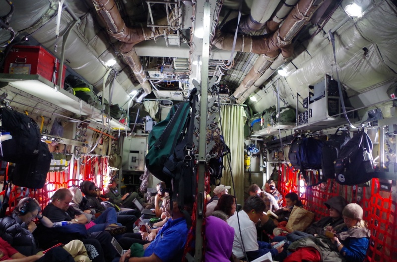 Passengers on board the C-130. © Mia Bennett, August 2014.