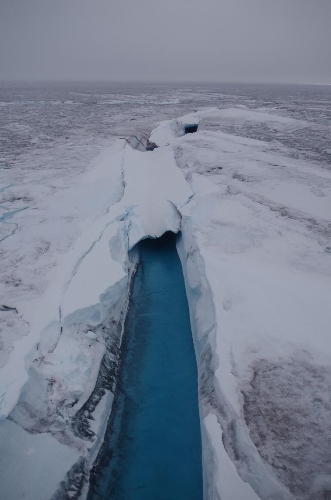 A supraglacial river. © Mia Bennett, August 2014.