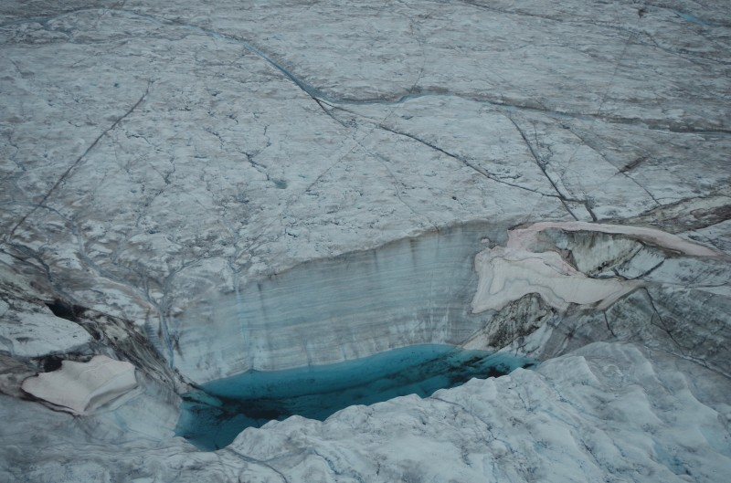 A moulin in a supraglacial lake on the Greenland Ice Sheet. © Mia Bennett, August 2014.