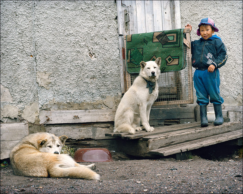 At the eastern end of the Russian Federation, a boy in Chukotka stands with his huskies. Photo: Flickr/Misha Maslennikov