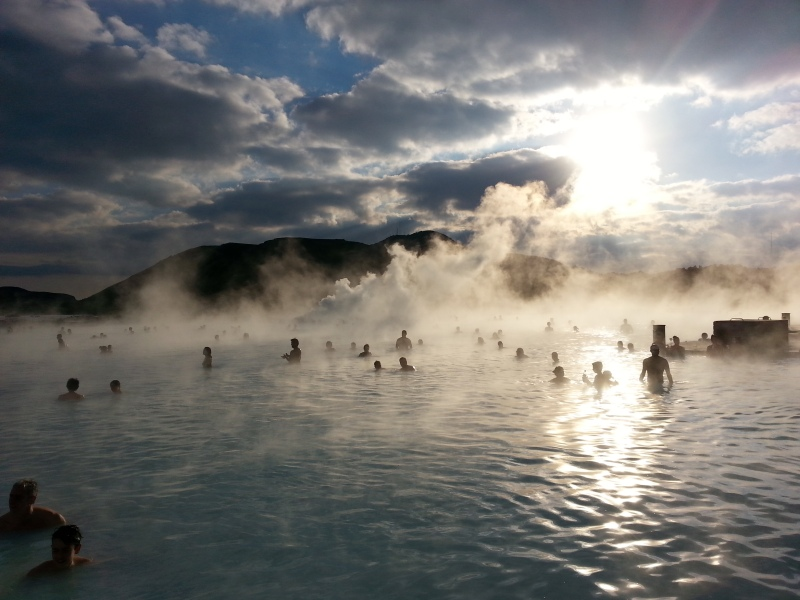 Tourists frolick amidst the geothermal steam of the Blue Lagoon. Reykjavik, Iceland. © Mia Bennett.
