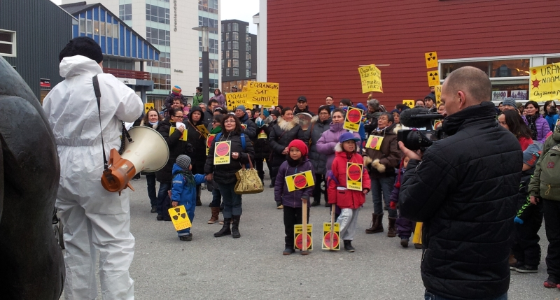 Never too young to get involved: protestors in Nuuk gathered outside parliament last year to fight overturning a ban on uranium mining. © William Davies, 2013.