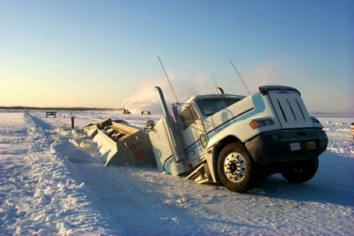 A truck that fell into a collapsed ice road. © Ice Road Truckers/History Channel