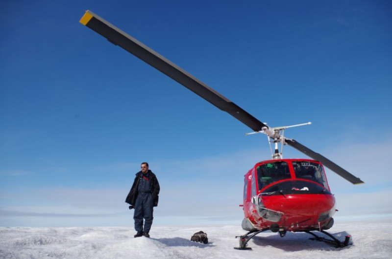 Our helicopter pilot, employed by Air Greenland, on top of the Greenland Ice Sheet. August 2014.