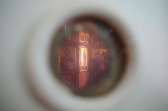 In the Russian Orthodox church on top of Sekirnaya Hill, the only trace of the gulag that once stood there is an unlabeled swinging door that still bears the peephole from its previous incarnation as a prison door.