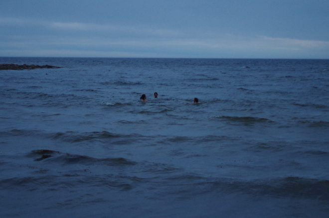 The author and friends swimming in the White Sea off Solovki.