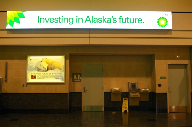 I wonder who paid more? Shell and the World Wildlife Foundation's competing signs at Ted Stevens International Airport in Anchorage, Alaska.