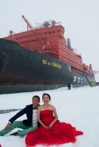 Chinese tourists sitting in wedding attire near the North Pole. Photo: Tatiana Posepelova