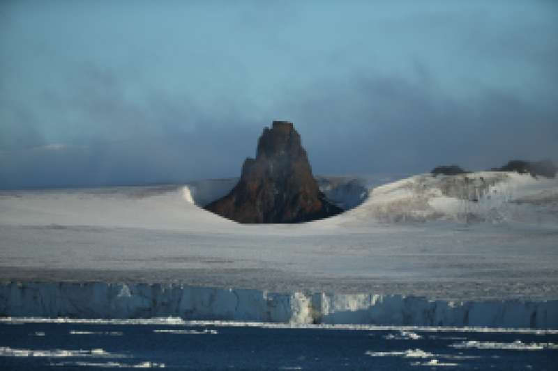 A mountain surges up out of the Arctic icepack. Photo: Tatiana Posepelova
