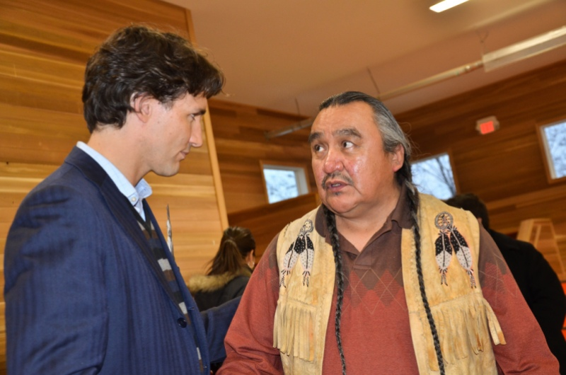 Justin Trudeau speaking with Chief Mike Archie of the Canim Lake Band, a First Nations group from British Columbia, in 2013. Flickr/Photo: Carl Archie, used under Creative Commons license.
