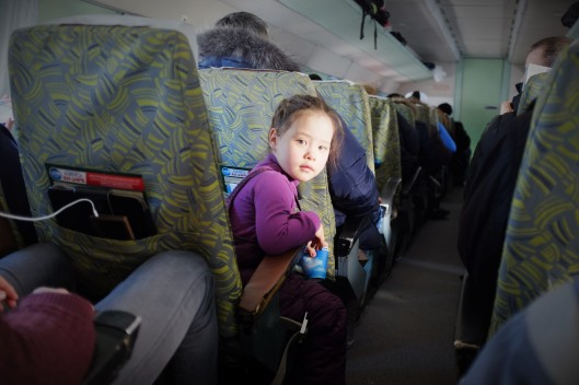 A girl on a Soviet-era plane between Mirny City and Yakutsk, Russia.