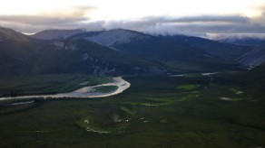 Looking over the Ogilvie Mountains in the Yukon, Canada in summer at midnight.