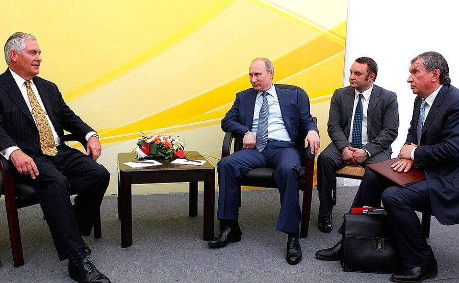 ExxonMobil CEO Rex Tillerson (left) meets with Russian President Vladimir Putin in Russia in 2012.